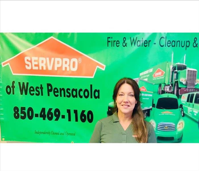 Connie from SERVPRO in front of Display
