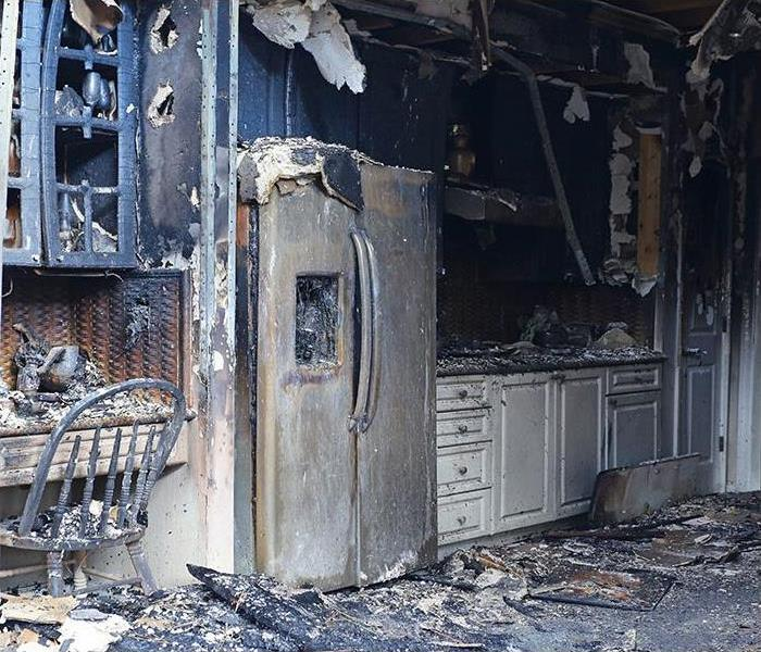 kitchen damaged by a fire and covered in soot