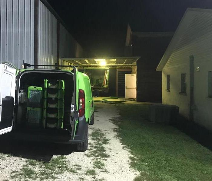 A SERVPRO van in a customers driveway.