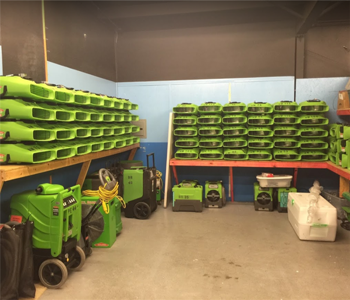 SERVPRO equipment stacked in storage facility